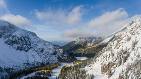 Mountain valley covered with fresh snow. Stock Photo