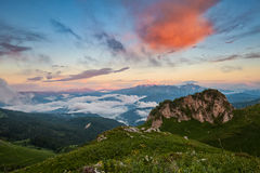 Free Mountain Valley Covered With Clouds At Sunset Royalty Free Stock Photography - 89529657