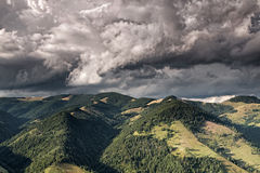 Mountain valley with dark rain clouds Stock Image