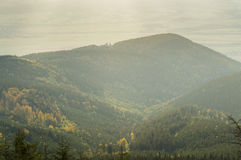 Mountain valley, the forest on the hills, vast fields in the distance. Royalty Free Stock Images