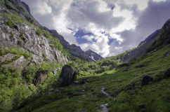 Mountain Valley Glencoe Scotland. A wide angle shot of a valley in the mountains of Glencoe, Scotland. This photograph shows the green, grassy hills of the Royalty Free Stock Images
