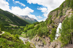 Mountain valley with waterfall Lillaz. Mountain valley in Gran Paradiso National Park, Italy Royalty Free Stock Photos