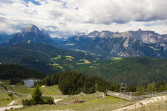 Mountain valley. With a green ski resort in summer and mountains in the back Stock Photo