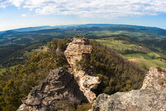 Mountain Valley Horizon Curve. Overlooking a rock mountain head into the valleys with green rolling hills of trees and vegetation. Horizontal photo image Stock Image