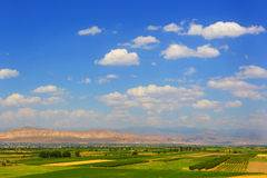 Mountain valley. Landscape of farmer fields. Air panorama with the blue cloudy summer sky stock photos