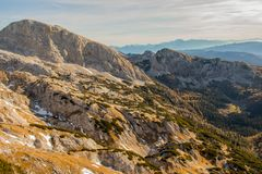 Mountain valley Laz with surrounding mountains. On a sunny day in julian alps Stock Photography