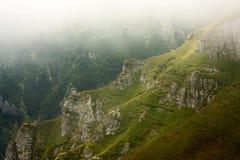 Mountain valley in the mist Stock Photos
