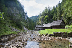 In the mountain valley an old watermill Royalty Free Stock Photos