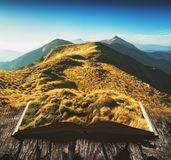 Mountain valley on the pages of an open book Stock Photo
