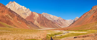 Mountain valley panorama in the Andes with hikers trekking, Argentina, South America Royalty Free Stock Images