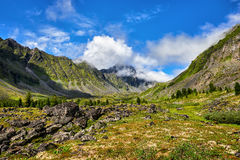 Mountain valley and peak in clouds Royalty Free Stock Photography