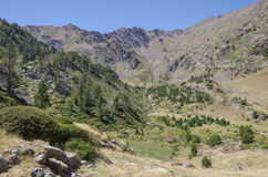 Mountain valley in Pyrenees near Coma Pedrosa peak Stock Photos