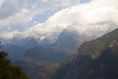 Mountain Valley. The snow capped Jade Dragon Snow Mountain in Yunnan Province with Tiger Leaping Gorge below Stock Photography