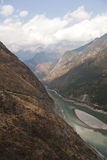 Mountain Valley. The snow capped Jade Dragon Snow Mountain in Yunnan Province with Tiger Leaping Gorge below Royalty Free Stock Photography
