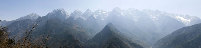 Mountain Valley. The snow capped Jade Dragon Snow Mountain in Yunnan Province with Tiger Leaping Gorge below Stock Image