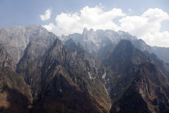 Mountain Valley. The snow capped Jade Dragon Snow Mountain in Yunnan Province with Tiger Leaping Gorge below Royalty Free Stock Photo