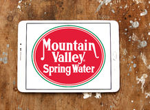 Mountain valley spring water logo. Logo of mountain valley spring water company on samsung tablet on wooden background stock images