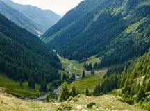 Mountain valley in a summer day Stock Photos