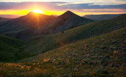 Mountain valley during sunrise. Royalty Free Stock Photos