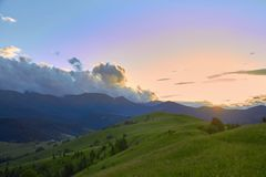 Mountain valley at sunset time, with a beautiful sky. Natural summer landscape stock image