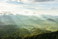 Mountain valley under mist and sunshine in the morning.  Royalty Free Stock Image