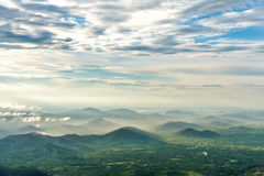 Mountain valley under mist and sunshine in the morning Stock Photography