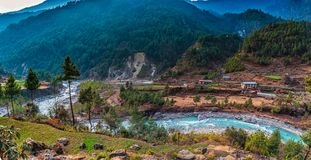 Mountain Valley with a Village and River royalty free stock image