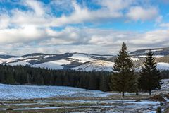 Mountain valley in winter time Stock Images