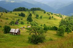 Mountain valley and wooden house Royalty Free Stock Photos