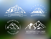 Mountain vector emblems on the blurred background. Stock Photo