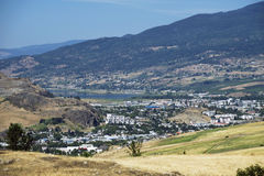 Mountain and Vernon. The city of Vernon by Kalamalka Lake stock image