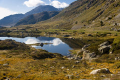 Mountain view. Summer day, blue sky in Andora - Pyrenees. Small pond Stock Image
