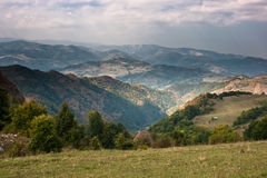 Mountain view. Image take from the top of a mountain in the Western Carpathian, Romania, showing a large view of the area royalty free stock images