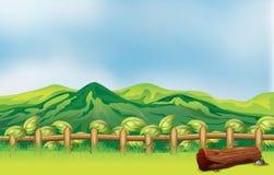 A mountain view across a wooden fence. Illustration of a mountain view across a wooden fence Stock Photos
