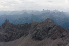 Mountain view in the alps in bavaria. This is a mountain view from the second highest peak in the bavarian allgäu mountains in the alps, the peak is called ` royalty free stock images