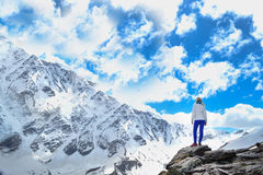 Mountain view.Blonde girl in the mountains. Sky with clouds Royalty Free Stock Photo