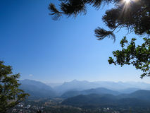 Mountain view with blue sky. Looking to mountain panoramic view with blue sky under the tree in the sunny day Stock Images