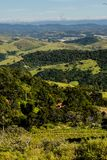 Mountain view from farm in Cunha, Sao Paulo. Mountain range in t. He background with green hills Royalty Free Stock Image