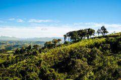 Mountain view from farm in Cunha, Sao Paulo. Mountain range in t. He background with green hills Stock Images