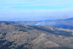 Mountain view of forest fire Royalty Free Stock Photography