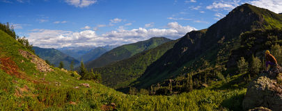 Mountain view with green forest and blue sky. A panorama of a valley at Khamar-Daban mountains near Baikal lake Stock Photos