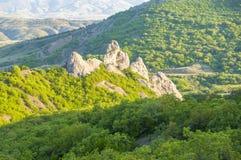 Mountain view with green juniper at sunset near Novyi Svit village, Crimea, Ukraine. Beautiful mountains with green juniper seen at sunset near New World village Royalty Free Stock Photography