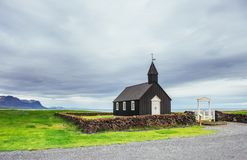 Mountain View Iceland. Beautiful black wooden church in Budir.  Stock Image