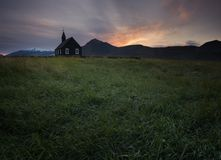 Mountain View Iceland. Beautiful black wooden church in Budir stock photo