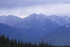Mountain View From Idaho Peak BC. View of the mountains from Idaho peak near Sandon, in British Columbia Canada. Taken during a light rain Royalty Free Stock Photos