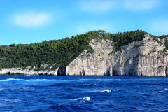 Mountain view from the Ionian sea. Dark blue sea. Blue water. Mountain forest Stock Photography