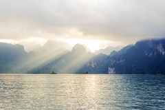 Mountain view with lake and sunray pass through the cloud. In Thailand surat Thani stock images