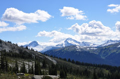 Mountain view landscape in British Columbia. Whisler and Blackcomb mountains in Canada provide one of the best all year around holiday mountain experience and Royalty Free Stock Image