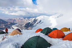 Mountain view from  Lenin peak camp 4. Climbers preparing for summit attempt in their tents Stock Photography