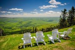 Mountain View - Mount Tremblant. Row of Adirondack chairs on Mount Tremblant summit facing out on mountain range Stock Photos